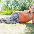 Royalty-Free Stock Photo: Pregnant woman in  summer park