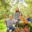 Stock Photo: Happy family with harvest