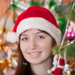 Portrait of girl in Santa hat — Stock Photo