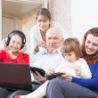 Happy  family together with few   devices at home — Stock Photo