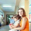 Womwith child at clinic — Stock Photo #25917249