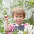 Baby girl in  blossoming garden — Stock Photo