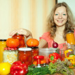Woman with pickled vegetables — Stock Photo #25917405