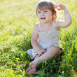 Baby girl in summer meadow — Stock Photo
