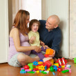 Happy family plays in home — Stock Photo
