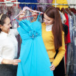 Stock Photo: Two women chooses evening gown