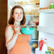 Royalty-Free Stock Photo: Pregnant woman eats from   fridge