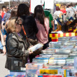 Stock Photo: Looking books on street stalls