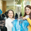 Stock Photo: Women chooses evening gown at shop