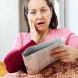 Woman having grief after readed news — Stock Photo