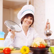 Cook in uniform cooking in kitchen — Stock Photo