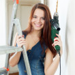 Woman in dungarees with drill — Stock Photo
