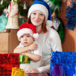 Mother and  son with Christmas gifts — Stock Photo