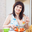Stock Photo: Positive girl eats veggie salad
