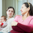 Adult daughter with baby tries reconcile with mother — Stock Photo #25919441