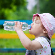 Baby drinks from plastic bottle — Stock Photo #25919461