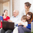 Stock Photo: Family enjoys in livingroom room with few laptops