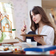 Woman paints home of dreams — Stock Photo