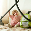 Baby girl with vacuum cleaner — Stock Photo #25919791