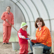women with child works at hothouse   — ストック写真