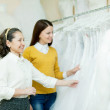 Bride chooses white gown — Stock Photo