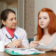 Woman doctor and teenager patient — Stock Photo