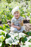 Girl in cucumbers plant — Stock Photo