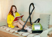 Woman rests from household chores — Stock Photo