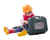 Child in hardhat chooses tools in toolbox — Stock Photo