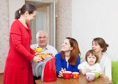 Happy family drinks tea and eats cakes — Stock Photo