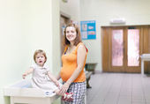 Pregnant woman with child at the clinic — Стоковое фото