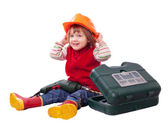 Happy child in hardhat with tools — Stock Photo