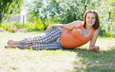 Pregnant woman in summer park — Stok fotoğraf