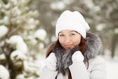 Portrait of girl in wintry clothes — Stock Photo