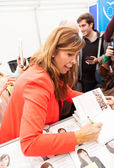 Alicia Sanchez-Camacho giving autograph on the book — Stock Photo