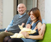 Happy couple with newborn baby — Stock Photo