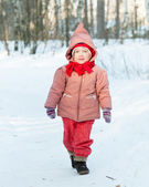 Baby girl in winter park — Stock Photo