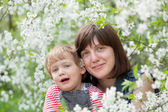 Happy mother with toddler in spring — Stock Photo