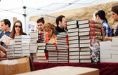 Books and red roses - symbols of Sant Jordi feast in Catalunia — Stock Photo