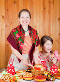 Women eating pancake with caviare — Stock Photo