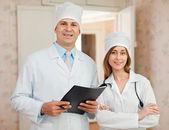 Doctors in hospital interior — Stock Photo