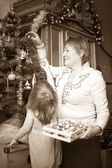 Woman and child preparing for Christmas — Stock Photo