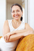 Portrait of beauty mature woman in home — Stock Photo