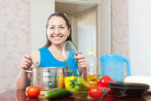 Happy mature woman with vegetables — Photo