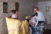 Priest at Sretenskaya church performing christening ceremony — Stock Photo