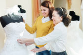 Mother with daughter chooses bridal gown — Stock Photo