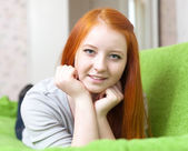 Red-haired teenager lying on couch — Foto Stock