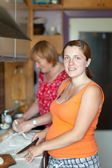 Two women cooks pasty — Stock fotografie
