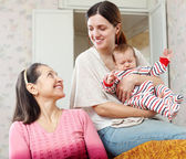 Woman talking to adult daughter with granddaughter — Stock Photo