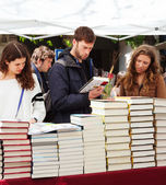 Books on street stalls. Focus on books — Stock Photo